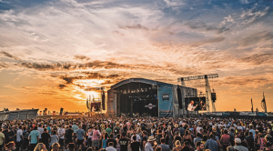Stage at Victorious festival with the sunset and a large crowd